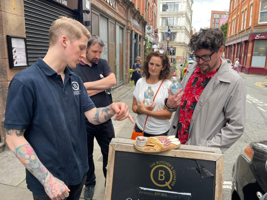 Enjoying a food tour in Manchester